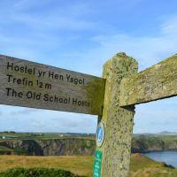 A487 dog walk and a dog-friendly pub, Wales - Old-School-Hostel-sign-on-Pembrokshire-Coast-Path-88-2-1704x986.jpg